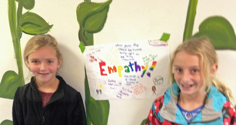 Two students with empathy poster.